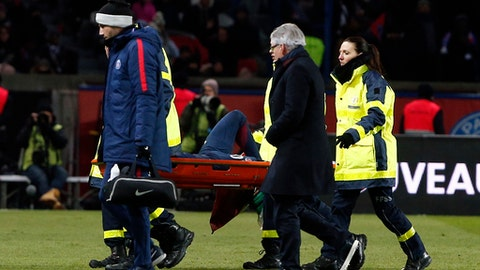 PSG's Neymar leaves the pitch on a stretcher after being injured during the French League One soccer match between Paris Saint-Germain and Marseille at the Parc des Princes Stadium, in Paris, France, Sunday, Feb. 25, 2018. (AP Photo/Thibault Camus)