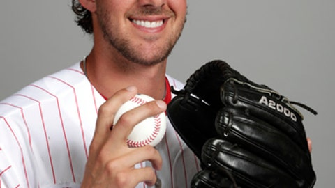 "File-This Feb. 20, 2018, file photo shows Aaron Nola of the Philadelphia Phillies baseball team. Gabe Kapler isn't one to wait. Nola will be his first opening-day starter as Philadelphia Phillies manager. ""Barring anything crazy happening, he's our guy. He is the man,"" Kapler said after Nola pitched two innings in his spring-training debut Sunday, Feb. 25, 2018, an 8-3 loss to the New York Yankees. (AP Photo/Lynne Sladky, File)"