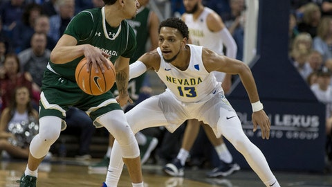 Colorado State's Anthony Bonner, left, dribbles against Nevada's Hallice Cooke, right, in the first half of an NCAA college basketball game in Reno, Nev., Sunday, Feb. 25, 2018. (AP Photo/Tom R. Smedes)