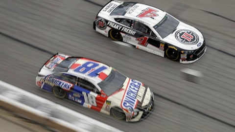 Monster Energy NASCAR Cup Series drivers Kyle Busch (18) and Kevin Harvick (4) races down the front stretch during the NASCAR Cup Series auto race at Atlanta Motor Speedway in Hampton, Ga., on Sunday, Feb. 25, 2018. (AP Photo/Paul Abell)