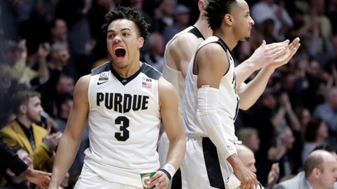 Purdue guard Carsen Edwards (3) reacts on the bench to a dunk in the second half of an NCAA college basketball game against Minnesota in West Lafayette, Ind., Sunday, Feb. 25, 2018. (AP Photo/Michael Conroy)