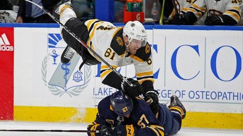 Buffalo Sabres forward Benoit Pouliot (67) brings down Boston Bruins forward Rick Nash (61) during the second period of an NHL hockey game, Sunday, Feb. 25, 2018, in Buffalo, N.Y. (AP Photo/Jeffrey T. Barnes)