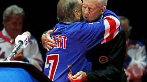 Hockey Hall of Famer Rod Gilbert embraces New York Rangers Hall of Famer Jean Ratelle, right, during a ceremony retiring Ratelle's number before an NHL hockey game between the New York Rangers and Detroit Red Wings at Madison Square Garden in New York, Sunday, Feb. 25, 2018. Ratelle, who played parts of 16 of his 21 NHL seasons with the Rangers, entered the Hockey Hall of Fame in 1985 and is second on the Rangers' goals list with 336 and third in assists with 481 and points with 817. (AP Photo/Kathy Willens)