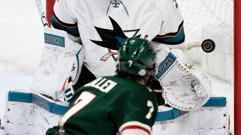 Minnesota Wild's Matt Cullen (7) scores a goal against San Jose Sharks goalie Martin Jones (31) during the second period of an NHL hockey game Sunday, Feb. 25, 2018, in St. Paul, Minn. (AP Photo/Hannah Foslien)