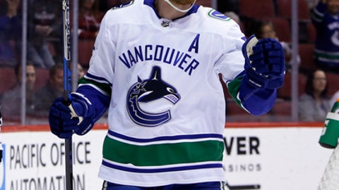Vancouver Canucks left wing Daniel Sedin reacts after scoring a goal in the first period during an NHL hockey game against the Arizona Coyotes, Sunday, Feb. 25, 2018, in Glendale, Ariz. (AP Photo/Rick Scuteri)