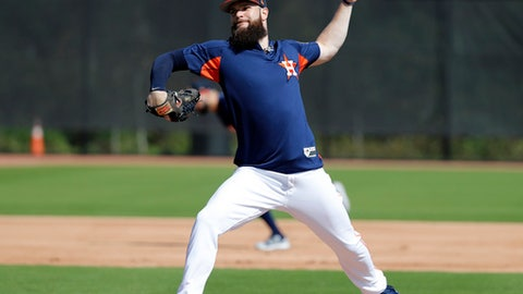 FILE - In this Feb. 19, 2018, file photo, Houston Astros pitcher Dallas Keuchel takes part in a drill during spring training baseball practice, in West Palm Beach, Fla. Keuchel has won a Cy Young Award and a World Series. Despite his success, the left-hander believes there's so much more to learn and is constantly studying the habits and routines of his Houston teammates hoping to pick up something that will help him improve. (AP Photo/Jeff Roberson, File)