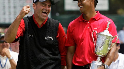 FILE - In this June 16, 2008, file photo, Rocco Mediate. left, jokes with Tiger Woods following Woods' U.S. Open championship victory after playing a sudden death hole following an 18-hole playoff round for the US Open championship at Torrey Pines Golf Course in San Diego. The U.S. Open is switching this year to a two-hole aggregate playoff. (AP Photo/Chris Carlson, File)