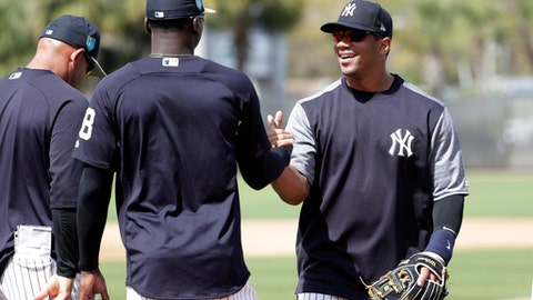 Seattle Seahawks NFL football team quarterback Russell Wilson, right, shakes hands with shortstop Didi Gregorius (18) at New York Yankees baseball spring training camp, Monday, Feb. 26, 2018, in Tampa, Fla.  (AP Photo/Lynne Sladky)