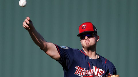 FILE - In this Feb. 17, 2018, file photo, Minnesota Twins relief pitcher Addison Reed practices during baseball spring training, in Fort Myers, Fla. The Twins signed Fernando Rodney to be their closer, but Addison Reed might have been an even more valuable addition in an age when ninth-inning use isn't necessarily reserved exclusively for a team's best reliever anymore.(AP Photo/John Minchillo, File)