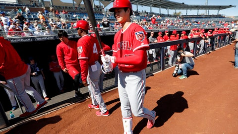 Los Angeles Angels' Shohei Ohtani walks to the on deck circle before batting during the first inning of a spring training baseball game against the San Diego Padres, Monday, Feb. 26, 2018, in Peoria, Ariz. (AP Photo/Charlie Neibergall)