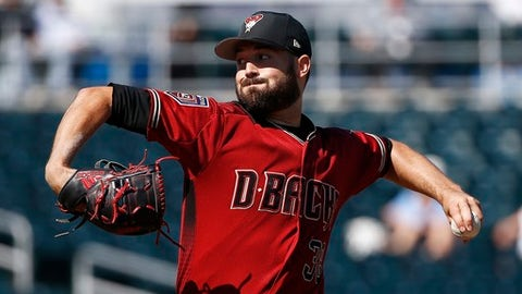 Arizona Diamondbacks pitcher Robbie Ray throws against the Cincinnati Reds during the first inning of a spring training baseball game Monday, Feb. 26, 2018, in Goodyear, Ariz. (AP Photo/Ross D. Franklin)