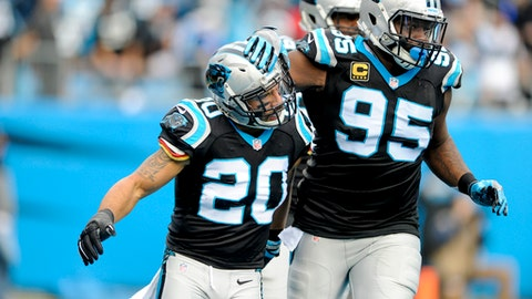 Carolina Panthers strong safety Kurt Coleman (20) and Carolina Panthers' Charles Johnson (95) react after sacking Atlanta Falcons quarterback Matt Ryan in the second half of an NFL football game in Charlotte, N.C. Saturday, Dec. 24, 2016. (AP Photo/Mike McCarn)
