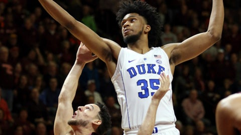 Duke's Marvin Bagley III (35) grabs an offensive rebound over Virginia Tech's Devin Wilson (11)  during the first half of an NCAA college basketball game Monday, Feb. 26, 2018, in Blacksburg, Va. (Matt Gentry/The Roanoke Times via AP)