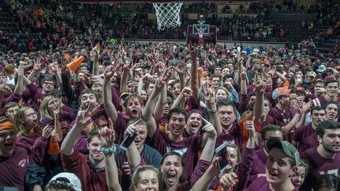 Virginia Tech fans storm the basketball court after defeating Duke after an NCAA college basketball game Monday, Feb. 26, 2018, in Blacksburg, Va. Virginia Tech won 64-63. (AP Photo/Don Petersen)