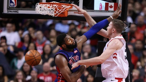 TORONTO, ON - February 26   In second half action, Toronto Raptors center Jakob Poeltl (42) drops one in around Detroit Pistons center Andre Drummond (0) The Toronto Raptors beat the Detroit Pistons 123 to 94 at the Air Canada Centre (ACC) in Toronto in NBA basketball action. February 26, 2018        (Richard Lautens/Toronto Star via Getty Images)