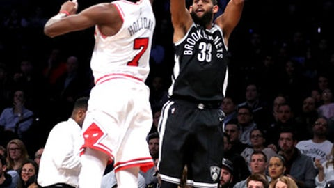 NEW YORK, NY - FEBRUARY 26: Allen Crabbe #33 of the Brooklyn Nets takes a shot against Justin Holiday #7 of the Chicago Bulls in the second quarter during their game at Barclays Center on February 26, 2018 in the Brooklyn borough of New York City. (Photo by Abbie Parr/Getty Images)