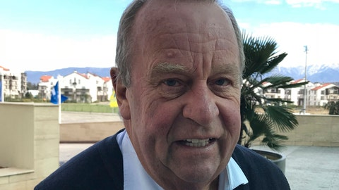 FIFA medical committee chairman Michel D'Hooghe poses after an interview with The Associated Press outside World Cup meetings in Sochi, Russia on Tuesday, Feb. 27, 2018.  World Cup finalists have been informed the use of video replays will be extended to team doctors to assist the diagnosis of concussions. FIFAs top medical official told The Associated Press that a second team doctor will be allowed access to match footage to evaluate injuries in real time to supplement any on-field diagnosis. (AP Photo/Rob Harris)
