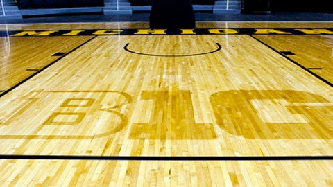 "FILE - In this Oct. 11, 2011, file photo, the new Big Ten Conference logo ""B1G"" is stained into the wood of the newly-renovated Crisler Arena court during NCAA college basketball media day in Ann Arbor, Mich. The Big Ten Tournament begins Wednesday, one week earlier than usual at a rather unusual venue: Madison Square Garden in New York.  (AP Photo/Tony Ding, File)"