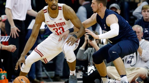 FILE - In this Jan. 25, 2018, file photo, Ohio State forward Keita Bates-Diop, left, drives against Penn State forward Deivis Zemgulis during an NCAA college basketball game in Columbus, Ohio. Chris Holtmanns first season coaching at Ohio State was a hit after the Buckeyes exceeded preseason expectations to finish 15-3 in the league to get the second seed in the Big Ten conference tournament. Bates-Diop, who averages 19.2 points and 8.9 rebounds per game, won league player of the year honors. (AP Photo/Paul Vernon, File)