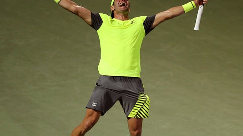 Malek Jaziri of Tunisia celebrates after winning his match against Grigor Dimitrov of Bulgaria during the Dubai Duty Free Tennis Championship in Dubai, United Arab Emirates, Tuesday, Feb. 27, 2018. (AP Photo/Kamran Jebreili)