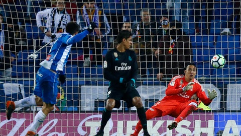 Espanyol Gerard Moreno, left, scores past Real Madrid's goalkeeper Diego Lopez during the Spanish La Liga soccer match between Espanyol and Real Madrid at RCDE stadium in Cornella Llobregat, Spain, Tuesday, Feb. 27, 2018. (AP Photo/Manu Fernandez)