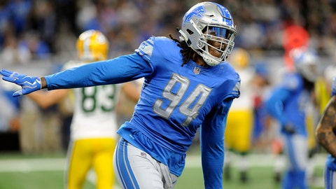 Detroit Lions defensive end Ezekiel Ansah (94) reacts after a sack during the first half of an NFL football game against the Green Bay Packers, Sunday, Dec. 31, 2017, in Detroit. (AP Photo/Jose Juarez)