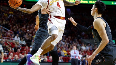 Iowa State's Donovan Jackson (4) passes the ball around Oklahoma State's Lindy Waters III during the first half of an NCAA college basketball game, Tuesday, Feb. 27, 2018, in Ames, Iowa. (AP Photo/Scott Morgan)