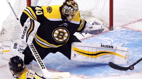 Boston Bruins goaltender Tuukka Rask makes a save during the first period of the team's NHL hockey game against the Carolina Hurricanes in Boston, Tuesday, Feb. 27, 2018. The Bruins defeated the Hurricanes 4-3 in overtime. (AP Photo/Charles Krupa)