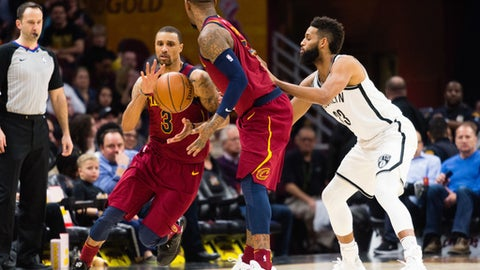 CLEVELAND, OH - FEBRUARY 27: George Hill #3 takes a pass from JR Smith #5 of the Cleveland Cavaliers while being guarded by Allen Crabbe #33 of the Brooklyn Nets during the second half at Quicken Loans Arena on February 27, 2018 in Cleveland, Ohio. The Cavaliers defeated the Nets 129-123. (Photo by Jason Miller/Getty Images)