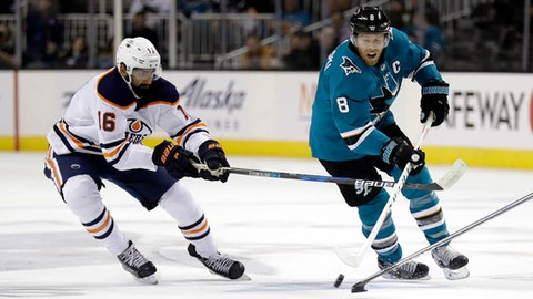 San Jose Sharks' Joe Pavelski, right, skates in front of Edmonton Oilers' Jujhar Khaira during the second period of an NHL hockey game Tuesday, Feb. 27, 2018, in San Jose, Calif. (AP Photo/Marcio Jose Sanchez)