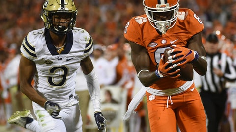 FILE- In this Nov. 12, 2016, file photo, Clemson wide receiver Deon Cain (8) makes a catch as Pittsburgh defensive back Damar Hamlin (3) defends during the second half of an NCAA college football game in Clemson, S.C. Deon Cain knows the questions are coming and he is looking forward to answering them this week at the NFL combine. Cain played three seasons at Clemson and was productive receiver for a team that made three playoff appearances and played in two national championship games. (AP Photo/Rainier Ehrhardt, File)