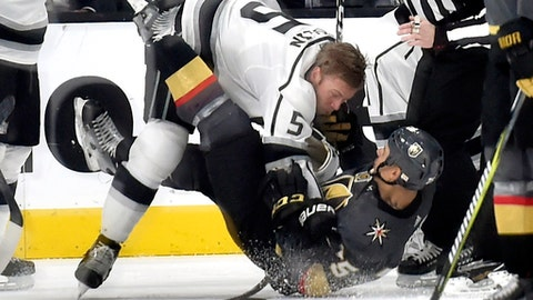 Los Angeles Kings defenseman Christian Folin (5) fights with Vegas Golden Knights right wing Ryan Reaves during the third period of an NHL hockey game Tuesday, Feb. 27, 2018, in Las Vegas. The Kings won 4-1. (AP Photo/David Becker)