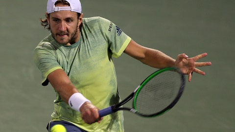 Lucas Pouille of France returns the ball to Karen Khachanov of Russia during the Dubai Duty Free Tennis Championship in Dubai, United Arab Emirates, Wednesday, Feb. 28, 2018. (AP Photo/Kamran Jebreili)