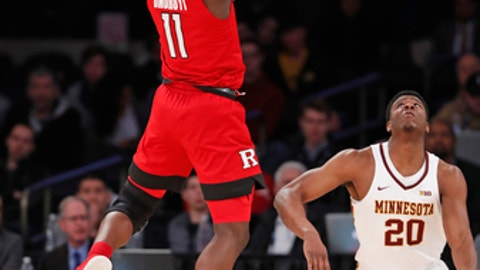Rutgers forward Eugene Omoruyi (11) shoots a 3-pointer over Minnesota forward Davonte Fitzgerald (20) during the first half of an NCAA college basketball game in the first round of the Big Ten men's tournament, Wednesday, Feb. 28, 2018, in New York. (AP Photo/Kathy Willens)