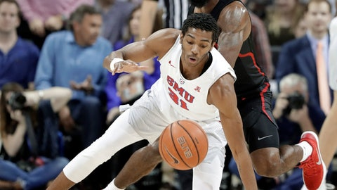 SMU guard Jimmy Whitt (31) loses control of the ball as Houston guard Corey Davis Jr., rear, defends in the first half of an NCAA college basketball game Wednesday, Feb. 28, 2018, in Dallas. (AP Photo/Tony Gutierrez)