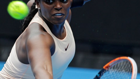 United States' Sloane Stephens eyes on the ball for a return to China's Zhang Shuai during their first round match at the Australian Open tennis championships in Melbourne, Australia, Monday, Jan. 15, 2018. (AP Photo/Dita Alangkara)