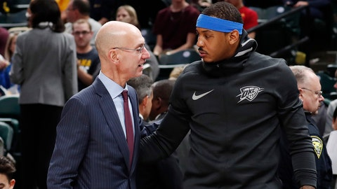 Dec 13, 2017; Indianapolis, IN, USA; NBA Commissioner Adam Silver talks to Oklahoma City Thunder forward Carmelo Anthony before the game against the Indiana Pacers at Bankers Life Fieldhouse. Mandatory Credit: Brian Spurlock-USA TODAY Sports