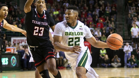 Feb 17, 2018; Waco, TX, USA; Baylor Bears guard King McClure (22) drives to the basked around Texas Tech Red Raiders guard Jarrett Culver (23) during the second half at Ferrell Center. Mandatory Credit: Andrew Dieb-USA TODAY Sports