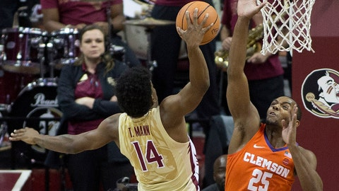 Feb 14, 2018; Tallahassee, FL, USA; Clemson Tigers forward Aamir Simms (25) fouls Florida State Seminoles guard Terance Mann (14) while shooting the ball during the first half at Donald L. Tucker Center. Mandatory Credit: Glenn Beil-USA TODAY Sports