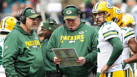 Dec 17, 2017; Charlotte, NC, USA; Green Bay Packers head coach Mike McCarthy talks withGreen Bay Packers quarterback Aaron Rodgers (12) during a timeout against the Carolina Panthers during the second quarter at Bank of America Stadium. Mandatory Credit: Jim Dedmon-USA TODAY Sports