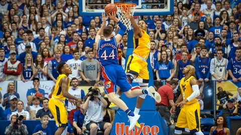 Feb 17, 2018; Lawrence, KS, USA; Kansas Jayhawks forward Mitch Lightfoot (44) shoots while defended by West Virginia Mountaineers forward Sagaba Konate (50) during the first half at Allen Fieldhouse. Mandatory Credit: Amy Kontras-USA TODAY Sports