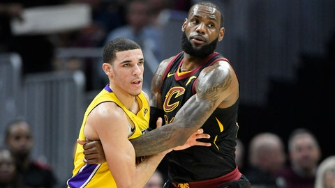 Dec 14, 2017; Cleveland, OH, USA; Los Angeles Lakers guard Lonzo Ball (2) defends Cleveland Cavaliers forward LeBron James (23) in the first quarter at Quicken Loans Arena. Mandatory Credit: David Richard-USA TODAY Sports