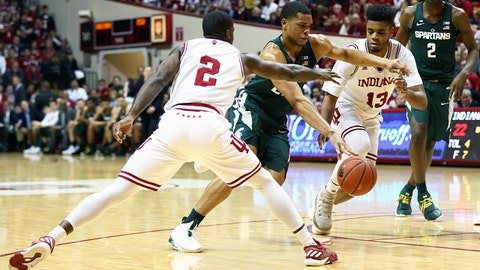 Feb 3, 2018; Bloomington, IN, USA; Michigan State Spartans guard Miles Bridges (22) drives to the basket against Indiana Hoosiers guard Josh Newkirk (2) and forward Juwan Morgan (13) in the first half at Assembly Hall. Mandatory Credit: Aaron Doster-USA TODAY Sports