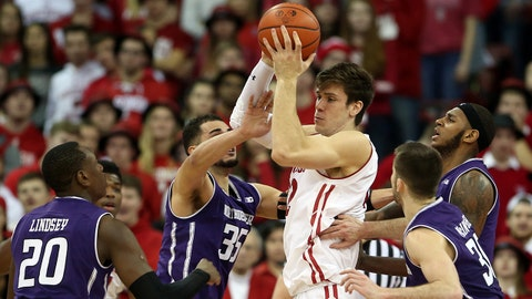 Feb 1, 2018; Madison, WI, USA; Wisconsin Badgers forward Ethan Happ (22) controls the ball asNorthwestern Wildcats guard Scottie Lindsey (20), forward Aaron Falzon (35), center Dererk Pardon (5), and forward Aaron Falzon (35) defend at the Kohl Center. Mandatory Credit: Mary Langenfeld-USA TODAY Sports