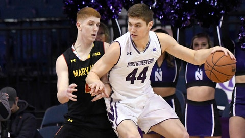 Feb 19, 2018; Rosemont, IL, USA; Maryland Terrapins guard Kevin Huerter (4) defends Northwestern Wildcats forward Gavin Skelly (44) during the first half at Allstate Arena. Mandatory Credit: David Banks-USA TODAY Sports