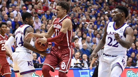 Feb 19, 2018; Lawrence, KS, USA; Kansas Jayhawks guard Malik Newman (14) bats the ball away from Oklahoma Sooners guard Trae Young (11) during the first half at Allen Fieldhouse. Mandatory Credit: Denny Medley-USA TODAY Sports