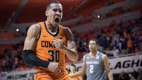 Feb 21, 2018; Stillwater, OK, USA; Oklahoma State Cowboys guard Jeffrey Carroll (30) reacts after dunking the ball during the second half against the Texas Tech Red Raiders at Gallagher-Iba Arena. Mandatory Credit: Rob Ferguson-USA TODAY Sports