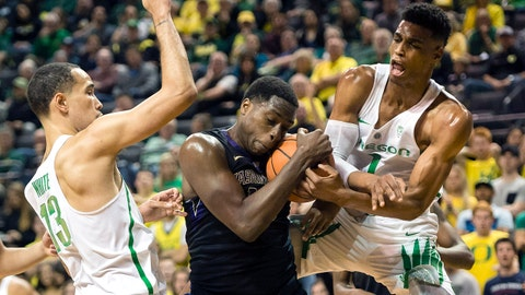 Feb 8, 2018; Eugene, OR, USA; Washington Huskies forward Noah Dickerson (15) grabs a defensive rebound away from Oregon Ducks forward Kenny Wooten (1) and forward Paul White (13) during the first half at Matthew Knight Arena. Mandatory Credit: Troy Wayrynen-USA TODAY Sports