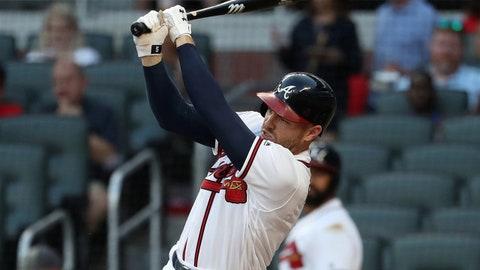 Aug 23, 2017; Atlanta, GA, USA; Atlanta Braves first baseman Freddie Freeman (5) hits an RBI double in the first inning against the Seattle Mariners at SunTrust Park. Mandatory Credit: Jason Getz-USA TODAY Sports