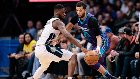 Feb 5, 2018; Denver, CO, USA; Denver Nuggets guard Emmanuel Mudiay (0) defends against Charlotte Hornets guard Michael Carter-Williams (10) in the first quarter at the Pepsi Center. Mandatory Credit: Isaiah J. Downing-USA TODAY Sports